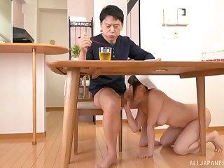 Japanese brunette MILF Tsukimoto Ai sucks a cock under the table