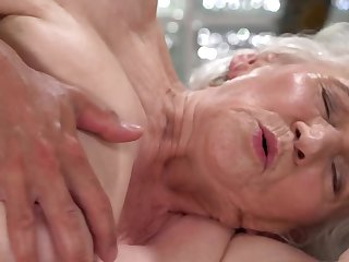 A nasty old granny is fucked on the side by a dude really hard