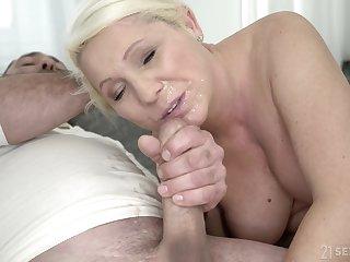 Mature blonde MILF Bibi Pink gets covered in cum after a hardcore fuck