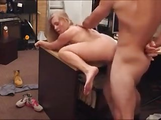 Beautiful blonde bimbo pawns her pussy and pounded