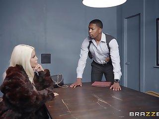 Blonde MILF slut Bridgette B rides cocks at a police station