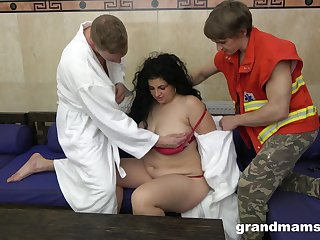 Mature BBW brunette takes two cocks in mouth and pussy