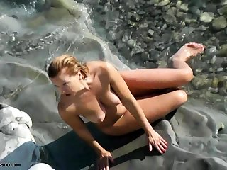 Nude lovers caught on beach cams