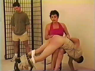 Strong woman spanks son and his friend