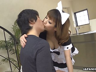 Naughty Japanese maid Yume Aino flashes boobies and gives nice titjob