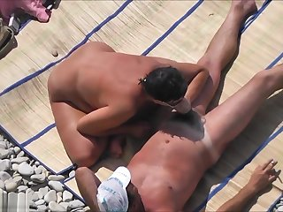 Voyeur Films A Couple Having Sex On The Beach