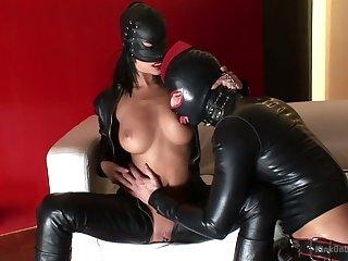Horny latex couple enjoys wild and kinky sex on the sofa