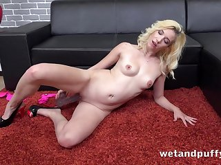 Pumped up pussy takes a big dildo nice and deep