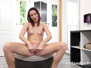 Girl opens up her pussy with a little red toy