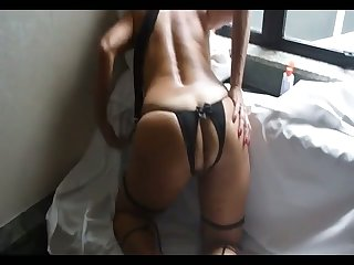 Stunning cam whore in sexy black stockings uses a dildo for her wet pussy