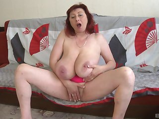 Busty mature plays with her fat cunt until she cums