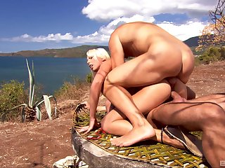 Blonde chick Diana Gold gets fucked in MMF threesome sex in the outdoors