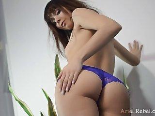 Solo babe Ariel Rebel in purple panties penetrating her vagina