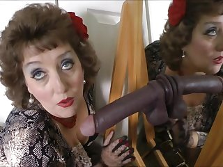 Horny mature woman plays with black fake cock