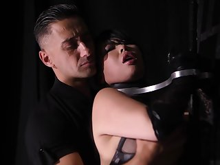 Big titted brunette in latex outfit, Tigerr Benson is having steamy sex with Mugur, all night long