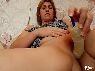 Redhead cougar uses a sex toy on herself