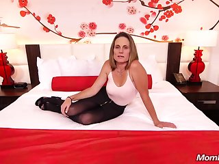 Skinny brunette milf with saggy tits, Judith, is riding a hard white cock for a camera