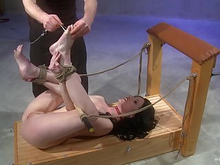Hardcore torture session with a cock hungry brunette slave