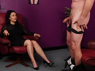 Clothed woman plays a bit dominant with her man